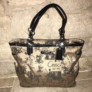 Gorgeous coach horse and carriage brown purse